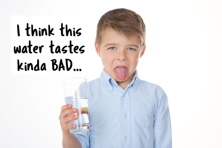 boy refusing to drink water